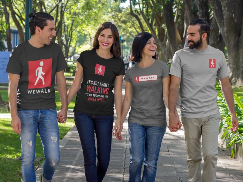 group of two couples walking and talking at a park while wearing differentt shirts template